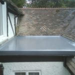 Fibreglass flat roofing installation in